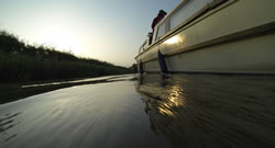 Photo of the side of a canal boat in the Ashby Canal near sunset