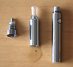 Kanger Evod e-cigarette components: battery, tank and atomiser on a wooden surface