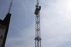 Crane and Vapour Trails